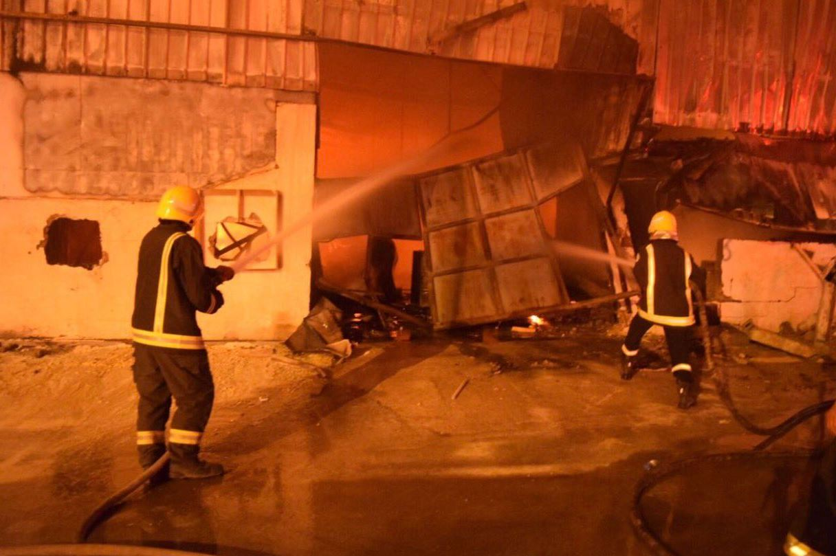 Firefighters in Riyadh try to control the flames that broke out in a carpentry workshop