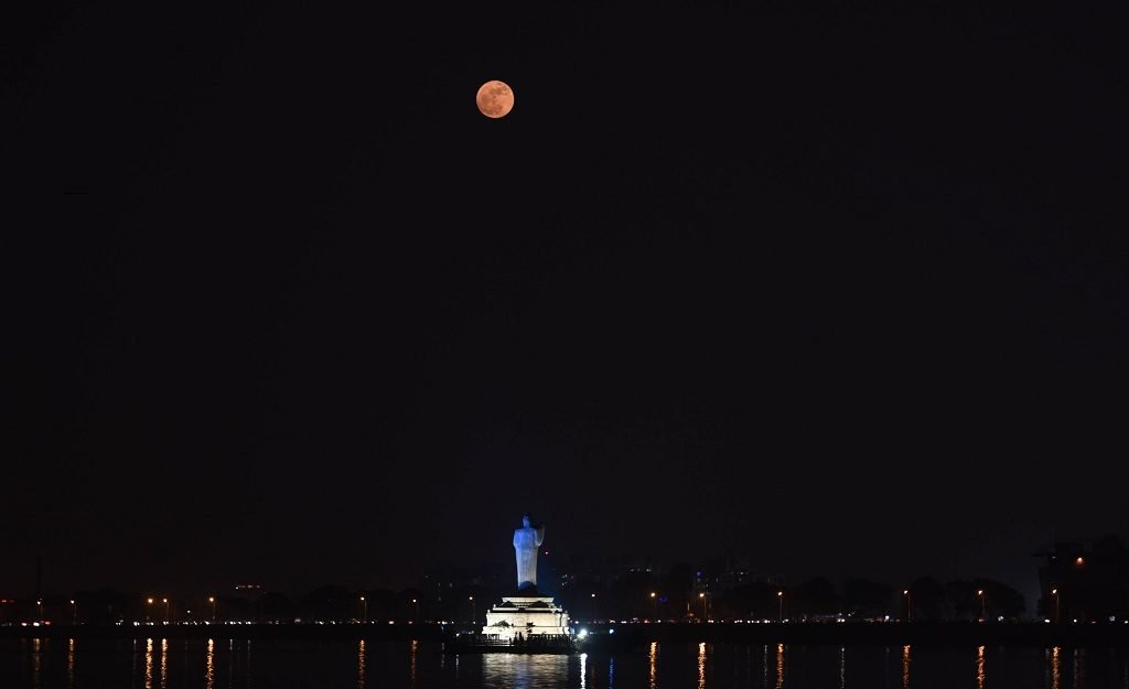 Residents get a glimpse of the 'supermoon' Sunday night